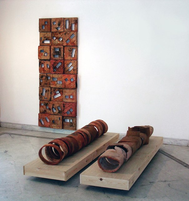 Earthenware, bisque at 1000c, pit firing with ferro choloride, 250cm &250cm &250cm, 2004