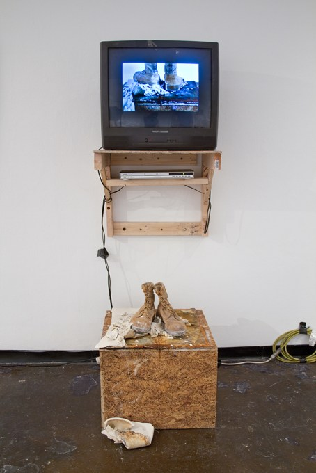 "TV, wood, steel, porcelain, ratchet strap, video (loop), US Army desert combat boot, extension cable, RCA cables, 100mph tape, 78x32x28"", 2016"