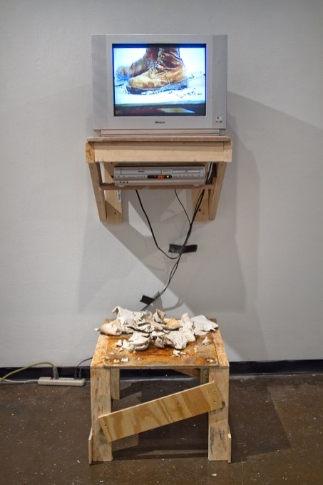 "TV, wood, steel, porcelain, 550 cord, video (loop), US Army desert combat boot, extension cable, RCA cables, 100mph tape, 78x32x28"", 2016"