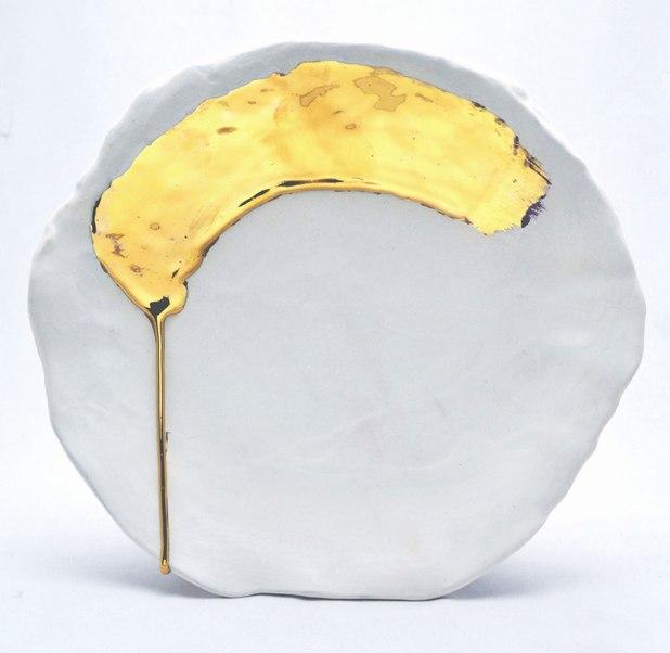 "Earthenware, slip, glaze, gold luster. Handbuilt. 14L"" X 13W"", 2014"