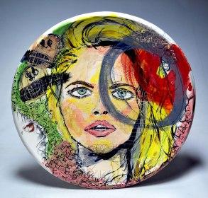 "Earthenware, slip, underglaze, underglaze pencil, glaze, gold and silver luster. Wheel thrown. 22L"" X 22W"", 2014."
