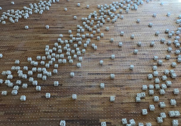 An 'event' (in Physics) is a moment specific to a place and time where a physical situation or occurrence is associated with a point in spacetime. Seeking to combine the different ways I represent time, I create these 'events' that bring together the representation of moments in time (tiny cubes) and the continuous cycle of time (big cubes) in site-specific installations. I place each cube, one by one, in a grid along the floor. Being on the floor and on the same plane as the viewer forces the viewer to confront the work and to become consciously aware of their body in space and time.