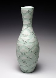 "porcelain & glaze with laser transfers, cone 10, 11"" x 4"""