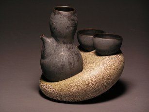 Thrown/inflated/altered with Barnard slip, satin black and reticulating glazes. Cone 10.