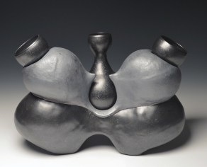 Hand-built and inflated with thrown servers. Barnard slip and satin black glazes. Cone 10.