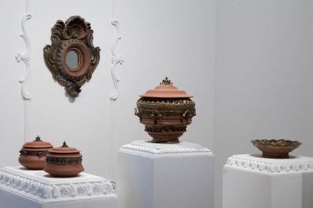 Installation View, Dimensions Vary. Ceramic, glaze, plaster. 2010