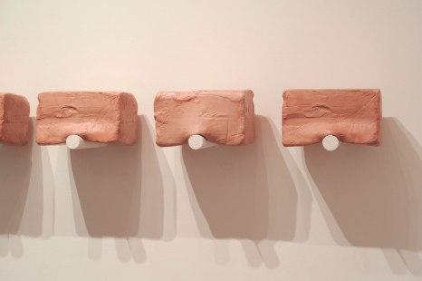 "detail, 2015, Slip Cast Ceramic, Stain, Wax, Paint, 7"" x 60"""
