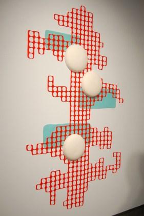 """porcelain, slipcast. Cone 04 oxidation. Plastic construction barrier, vintage foam carpet padding, 72""""x48""""x3"""""""
