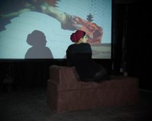 GIF animation of Benjamin-Constant's Odalisque is projected as the artist destroys a chaise longue made entirely of wet clay with her body weight.