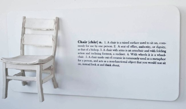 "wood panel, porcelain press mold, cast chair and screen printing text. 24"" x 48"" x 12"". 2010"