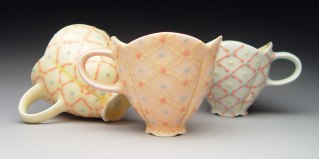 "Wheel-thrown and altered porcelain, colored slips and glaze, cone 6 - 3.5""x3""x3"" each"