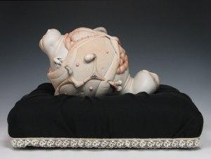 "Baby, porcelain, hair, steel (base: chiffon), 12"" x 15"" x 9"", 2009"