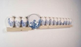"Slip cast and found-manufactured ceramic, wood, 84 x 14 x 6"""