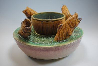 "wheel thrown, slab built, and press molded, stoneware c/9 reduction fired, 16""dia x 10""h"