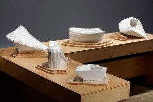 "(Installation: Group of 5), 2012, Porcelain, wood, felt; 16""h x 84""w x 60""d"
