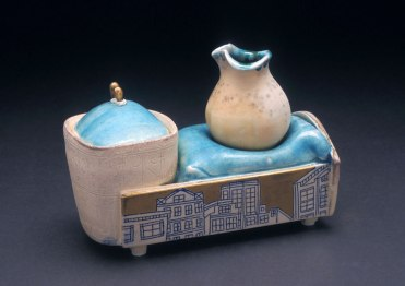 "porcelain, thrown and altered, cone 6 soda firing neutral environment, 7""x 4"" x 6"""