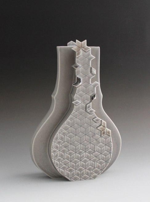 "2015. Slip cast porcelain using modular mold system, appliqué, 9"" x 3"" x 12″"