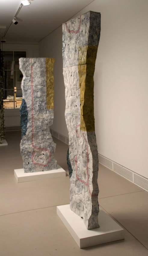 "Columns, 2012, Clay, glaze and steel. Each column 20""x7""x70"""