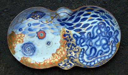 """2012, Terracotta clay, maiolica, gold luster, china paint, 14W"""" x 8.5""""H x 1.5""""D"""