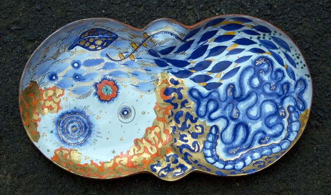 "2012, Terracotta clay, maiolica, gold luster, china paint, 14W"" x 8.5""H x 1.5""D"