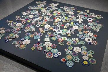 "Porcelain, glaze, paper, rubber, glass beads, 72""L x 72""W x 2"" H, 2012"
