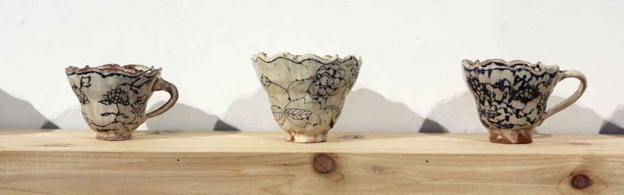 """cup row detail, pinched earthenware, mishima, slip, glaze, avg. cups approx.. 3.5""""h x 3""""w x 3""""d, 2015"""