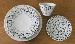 Wheel-thrown porcelain, underglaze and custom gold decals, cone 7 & 018 oxidation, variable sizes