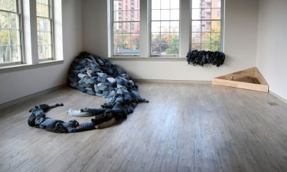 Jeans, wood pellets, twine, scoop, scissors, plywood, participants, 8'x16'x4' overall, variable, 2012