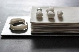"Oxidation fired porcelain, glaze, steel. 2013. 9 3/4"" x 5"" x 2 1/2"""