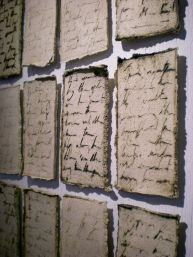 """Installation of porcelain paper clay pages, Porcelain, Cone 6 Oxidation, Oxide Wash, 2011, 6'x3'x.25"""" (variable)"""