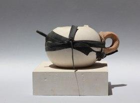 Plaster base and body, bike tube, shard of an archeological handle, 24 x 20 cm. 2013