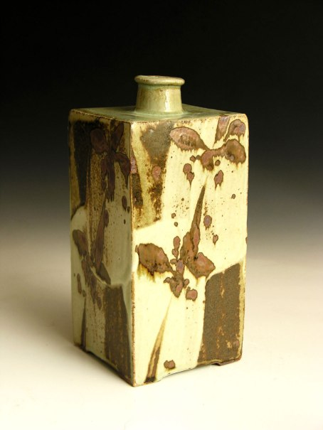 Iron pigment decoration. 9 inches tall.