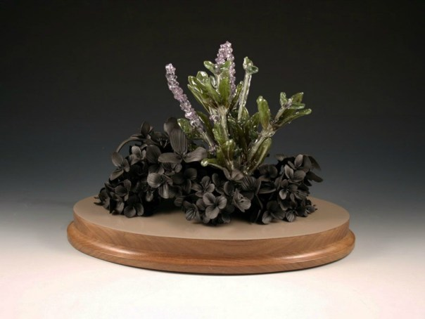 """hand formed black clay, resin dipped silk flowers, wood, paint, 14"""" x 10"""" x 8"""""""