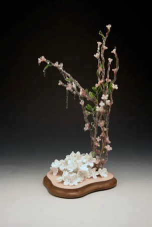 "porcelain, resin dipped silk flowers, aged walnut, paint, 18"" x 10"" x 8"""