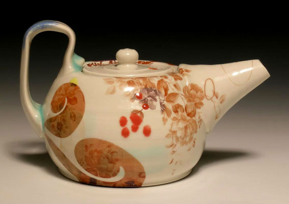 "10""w x 4""h x 6""d, mid-range porcelain, oxidation, with laser transfers"
