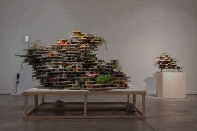"60"" x 75"" x 64.8"", Concrete, cardboard, acrylic, HO-scale figures, led lights, paint and plants, 2012"