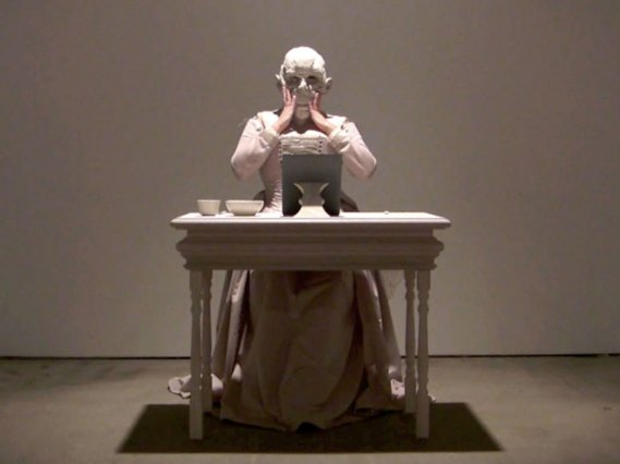 Video Still 2010, Raw clay, costume, wooden table and stool, mirror