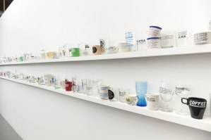 "(installation view), 3'x24'x4"", commercially produced ceramic and glass ware with screen print decals, 2014"