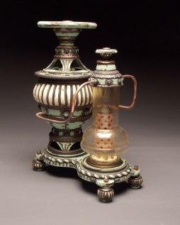 "Wheel thrown and hand built mid-range stoneware, terra sigillata, glaze, fired to Cone 6 oxidation, glass found object, copper tubing. 17"" x 13"" x 8"". 2013"