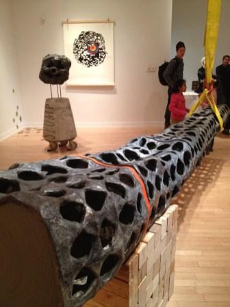 2013 – gallery view. Ceramic (earthenware, slip, terrasigillata, glaze), hardware, vinyl, rubber, industrial load-binder strap, wood. 305 x 92 x 203 cm.
