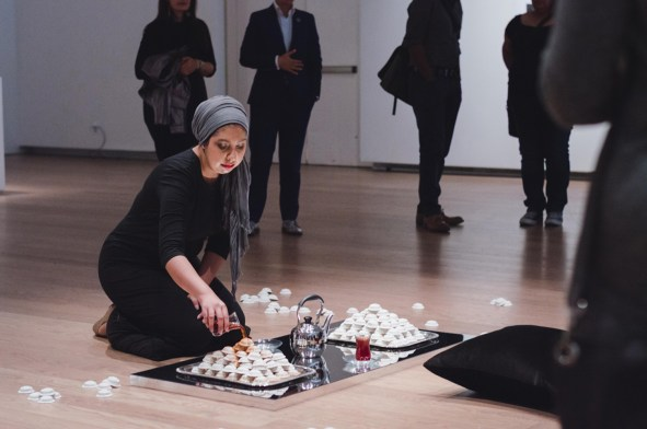 This piece consists of multiple short performances and involves the pouring of tea on unfired clay cookies as a way to explore cultural and familial loss.