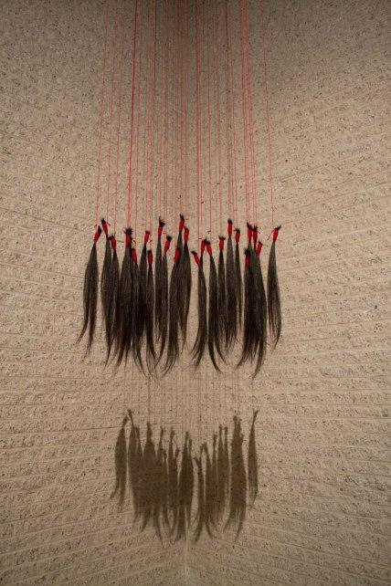 "Artist' hair, red thread, steel, 8' x 14"" x 1"", 2015"