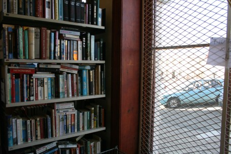 The bustling Bathurst Street can be seen through the window when picking out books from the sale section.