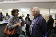 Prof Jeff Opland in hearty conversation after the showcasing of his work.