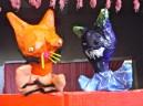 Orange fox and blue dinosaur