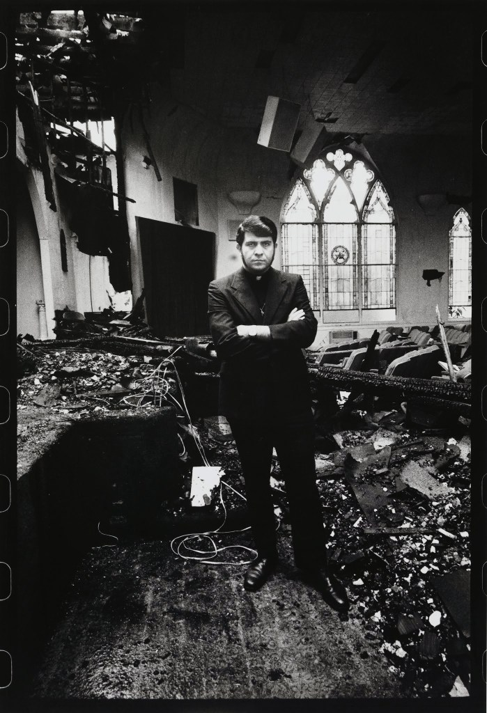 Anthony Friedkin The Reverend Troy Perry, Gay Activist, in His Burnt Down Church, Los Angeles, 1973 Gelatin silver print 14 × 11 in. (35.6 × 27.9 cm) Fine Arts Museums of San Francisco Anonymous gift in honor of Sheila Glassman