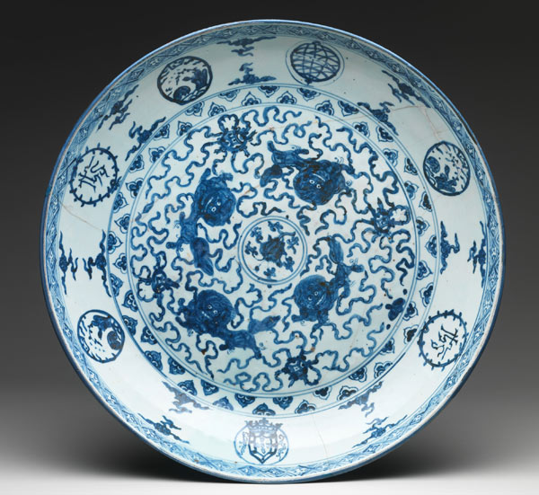 This plate was designed specifically for the Portuguese court, as evidenced by the Portuguese coat of arms in the bottom-center roundel. Dish with IHS monogram, armillary sphere, and Portuguese royal arms, ca. 1520–40. Chinese. Hard-paste porcelain with underglaze cobalt blue decoration (Jingdezhen ware); H. 3 3/4 in. (9.5 cm.); Gr. diam. 20 3/4 in. (52.7 cm.). The Metropolitan Museum of Art, New York, Helena Woolworth McCann Collection, Purchase, Winfield Foundation Gift, 1967 (67.4)