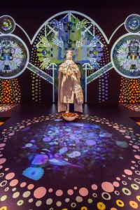 Installation view of ChimaTEK: Virtual Chimeric Space (detail), 2015, at Seattle Art Museum, Saya Woolfalk, United States, b. 1979, installation with five costumes with 3-D masks and video, dimensions variable, Seattle Art Museum, Commission, 2015. © Seattle Art Museum, Photo: Nathaniel Willson.