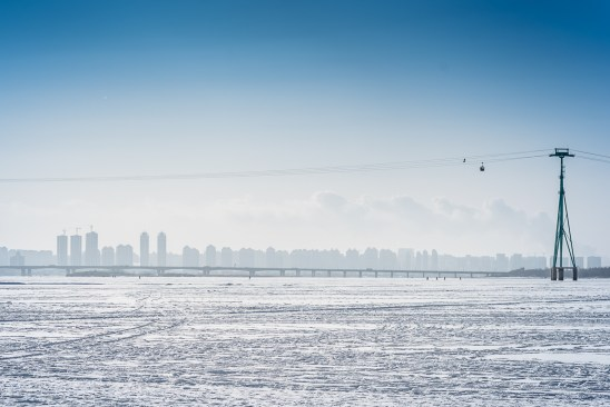 Harbin skyline and cable car from the frozen Songhua river