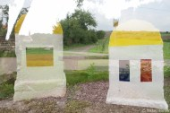 Double exposure of German and French flags on both sides of a milestone